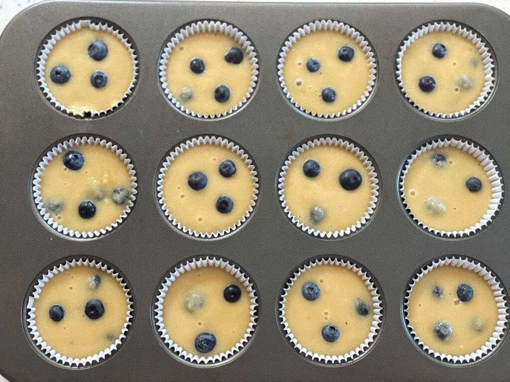 healthy Blueberry Muffins in a muffin tin