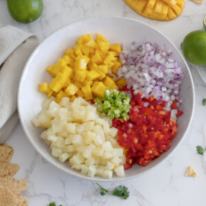 Mix all the ingredients in a bowl for pineapple mango salsa