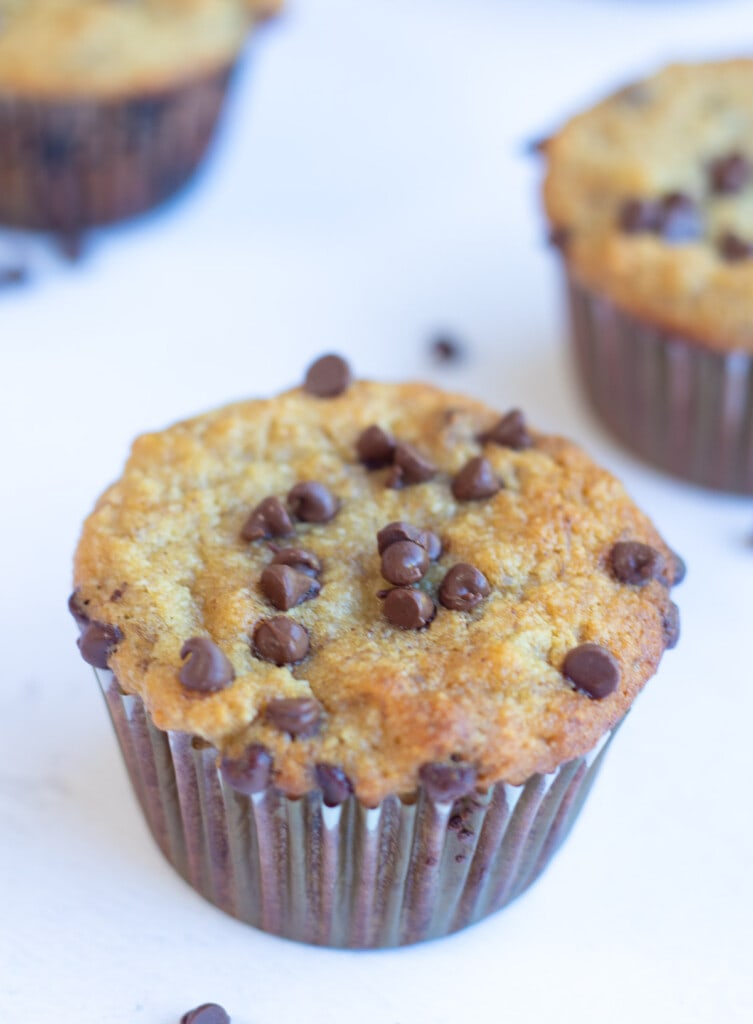 Banana chocolate chip muffins on a white table