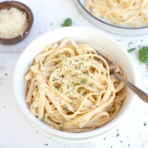 Instant pot Fettuccini Alfredo served in a bowl topped with parmesan
