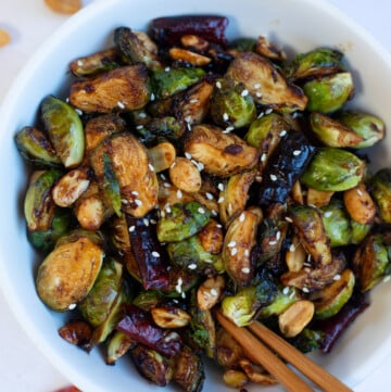 Chinese style Brussels sprouts kung pao in a white bowl