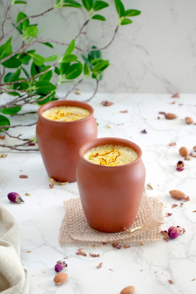 Almond doodh garnish with saffron and pistachio