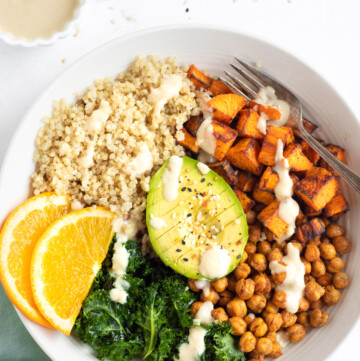 Healthy Vegan bowl with quinoa, sweet potato, chickpeas, kale and avocado