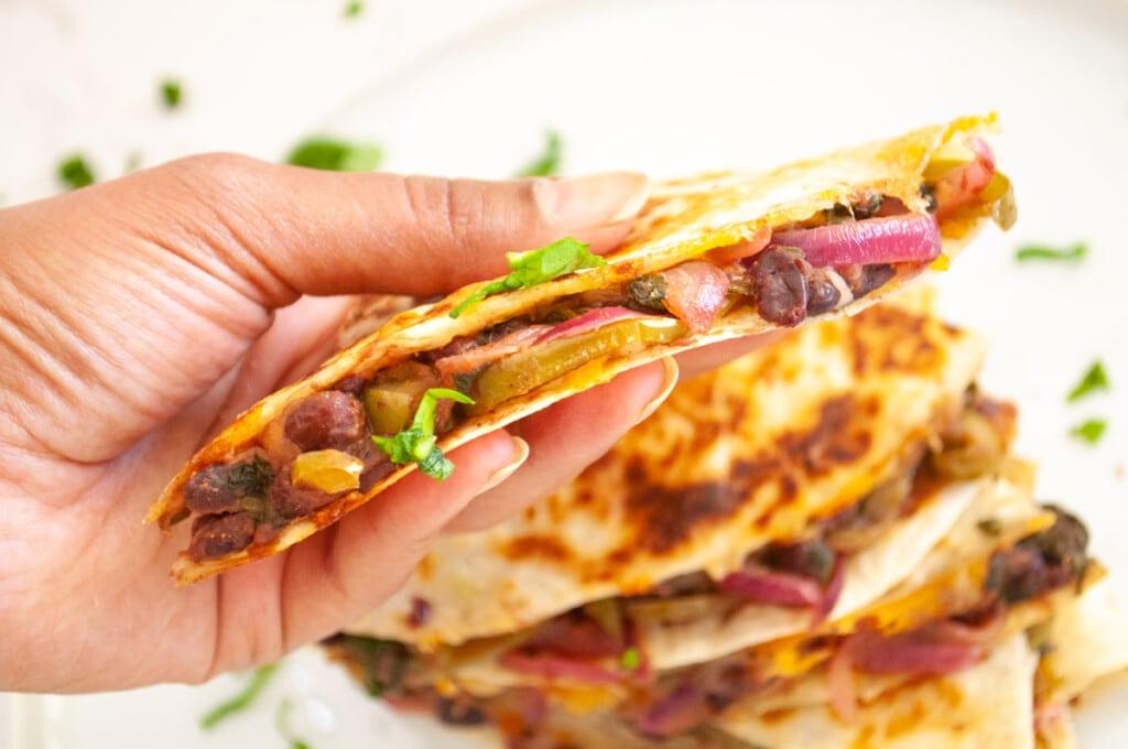 closeup of a vegetarian black bean quesadilla with fajita