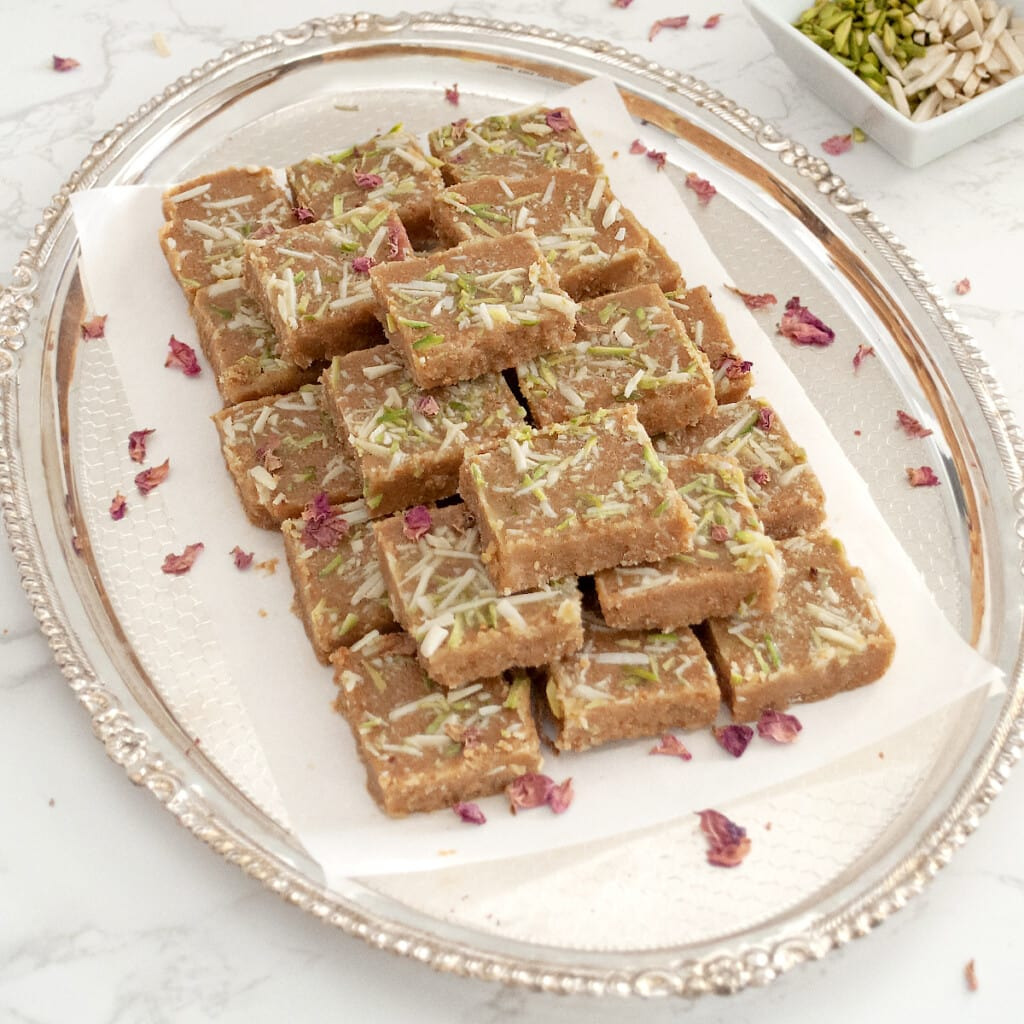 traditional Gujarati magas sweet in a serving tray garnished with rose petals